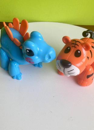 Игрушки- трещетки tolo: тигренок и динозаврик