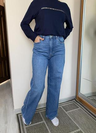 Широкі джинси з високою посадкою
