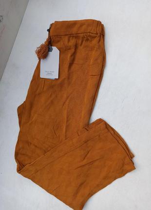 Укорочені штани для дівчинки на зріст 152 см.