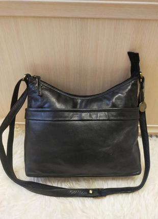 Практичная кожаная сумка на плечо taurus