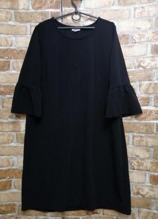 Платье из плотного фактурного трикотажа