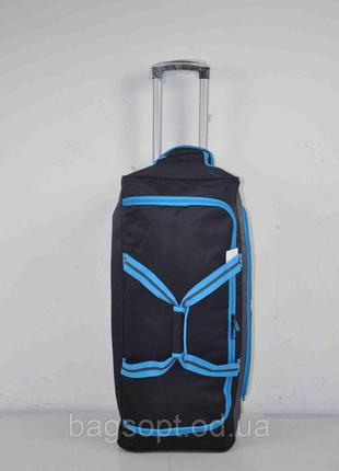 Большая вместительная дорожная сумка на колесах с выдвижной ручкой