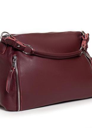 Женская кожаная сумка изготовлена из натуральной мягкой кожи.