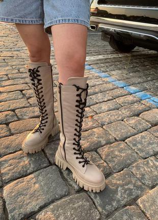Женские кожаные сапоги на тракторной подошве 2111