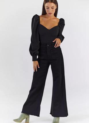 Черные джинсы палаццо