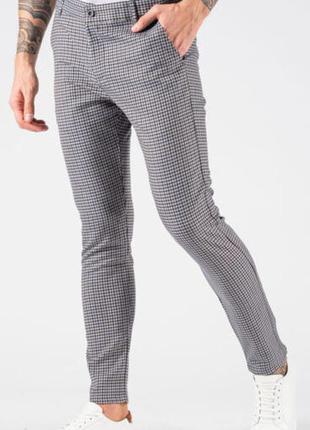 Шикарные стильные зауженные брюки в мелкую разноцветную клетку  primark.