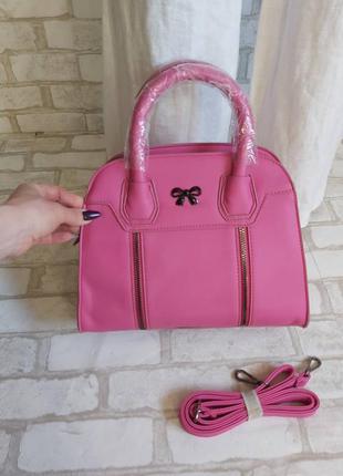 Новая с биркой фирменная сумка в розовом цвете среднего размера с длинной ручкой