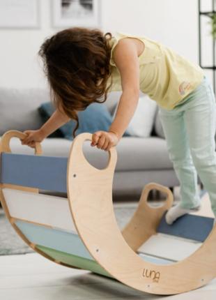 Яскрава різнокольорова качалка – ексклюзивна дерев'яна іграшка, виконана з еко-матеріалів
