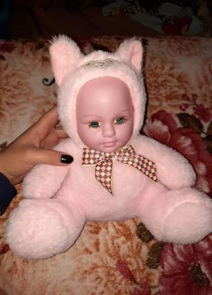 Кукла хохотушка