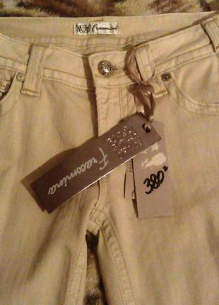 Продам фирменные новые джинсы -брюки