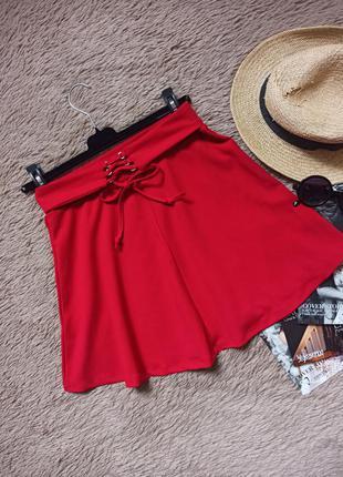 Яркая короткая юбка солнце клеш со шнуровкой/спідниця