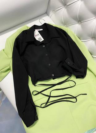 Нова чорна блуза із зав'язками