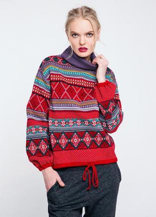 Красивый трендовый вязаный свитер скандинавский стиль