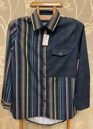 Очень красивая и стильная блузка в полоску.