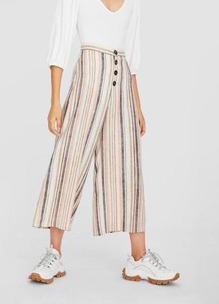 Широкие льнягые брюки на лето в цветную полоску