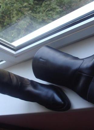 Prada черного цвета женские кожаные сапоги