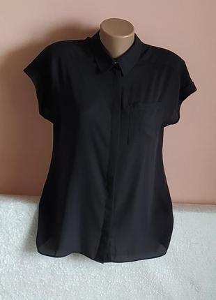 В ідеалі, не носили!шикарна чорна блузочка,вказано р.12.