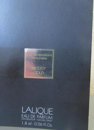 Парфюмированная вода woody gold lalique 1,8 мл.