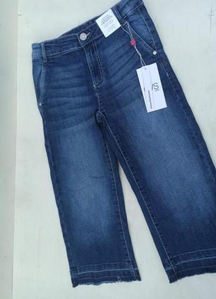 Укорочені джинси кльош на зріст 128 см.