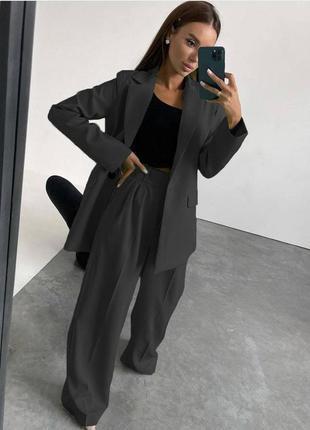Трендовый брючный костюм оверсайз пиджак и брюки палаццо в наличии в цветах