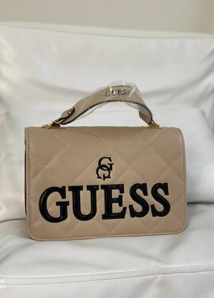 Женская бежевая кожаная сумочка guess