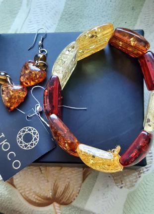 Очень красивый браслет и серьги фирмы тюсо(янтарь)