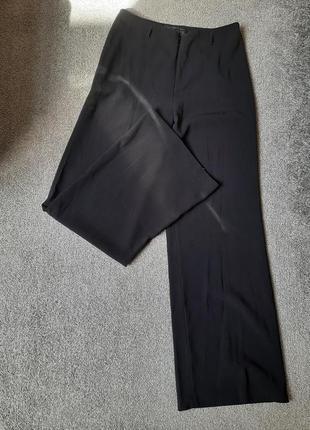 Широкие брюки на низкой посадке