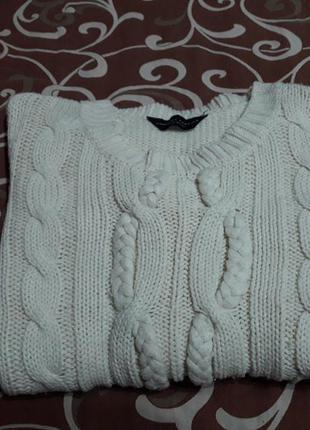 Молочный свитер в косы