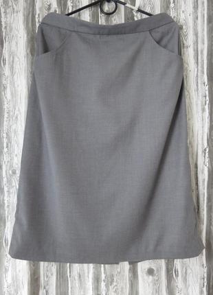 Юбка серого цвета, с карманами новая 48 размер