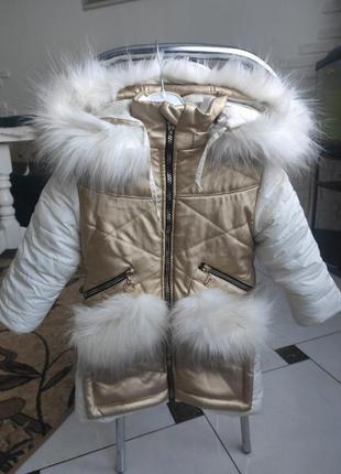 Зимова куртка,плащ.