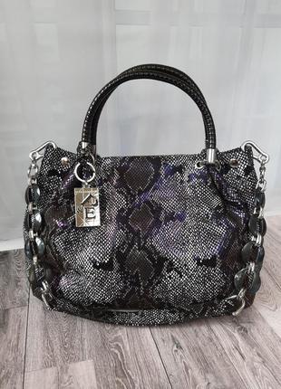 Polina & eiterou. дуже стильна сумка з атуральної замшї з лазерною обробкою.