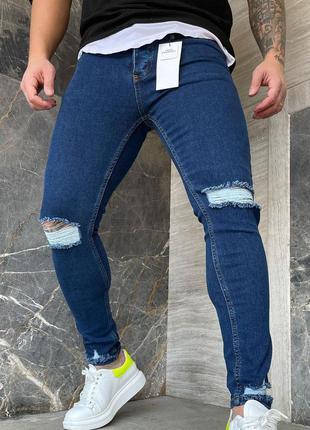 Мужские синие джинсы зауженные рваные