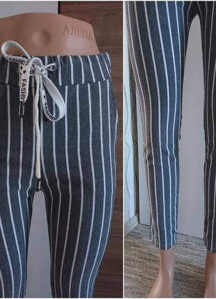 Полосатые брюки с блестящей ниткой