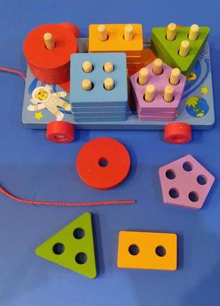 Дерев'яна іграшка-каталка геометрика