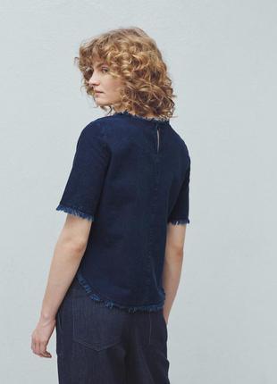 Джинсовая блузка с коротким рукавом и бахромой