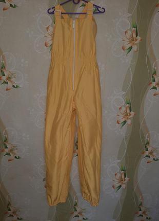 Зимний комбинезон ярко желтого цвета