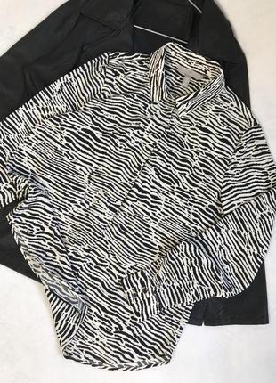 Актуальная оверсайз блуза в принт зебры h&m
