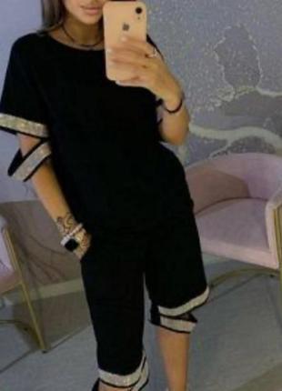 Стильный костюм, люкс качество,камни сваровски,размер 4 хл.