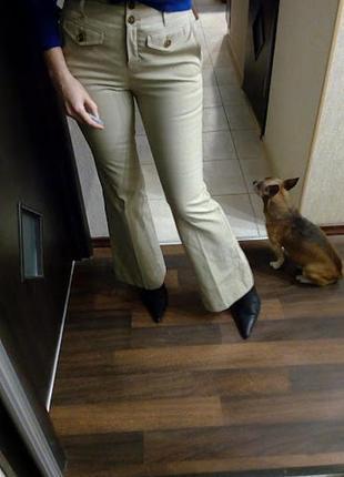 Бежевые бандажные брюки клеш с высокой талией