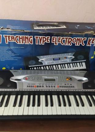 Профессиональный детский синтезатор iplay em mk 2061