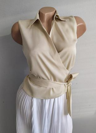 Блуза из 100% шелка короткая с запахом.
