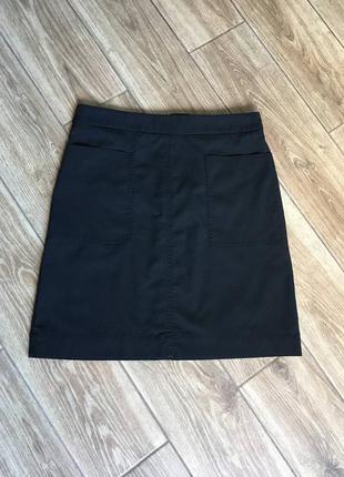 Мини юбка черная трапеция, накладные карманы