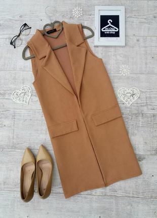 Стильний, подовженний жилет кольору camel від new look.