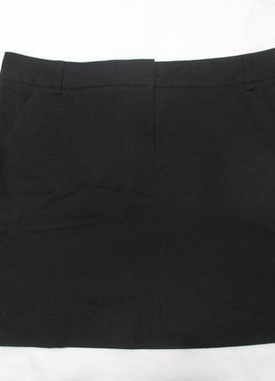 Деловая черная юбка с карманами