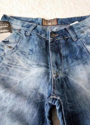 Новые джинсы с косыми карманами по закупке.турция