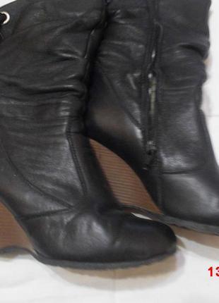 Кожаные зимние ботинки на танкетке
