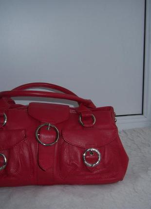 Красивая кожаная сумка фирмы tommy kate