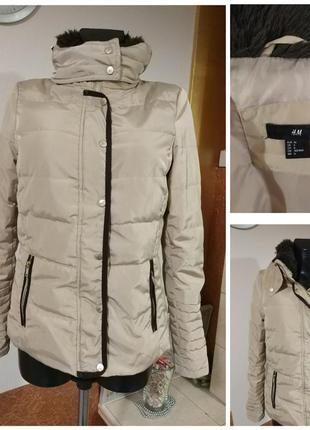 Фирменная ,стильная, пуховая тёплая куртка.