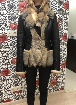 Куртка кожаная с мехом волка2 фото