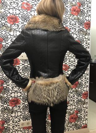 Куртка кожаная с мехом волка4 фото